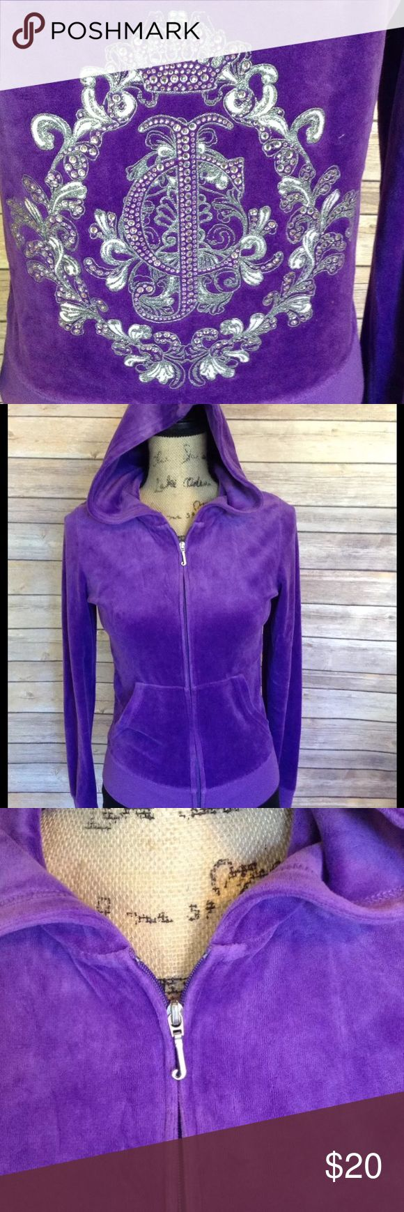 "Juicy Couture size medium purple zip up hoodie Pre-owned Juicy Couture women's size medium purple zip up hoodie. Back has JC with decorative scroll around it embroidered with glitter and bling. Excellent used condition. No rips holes or stains. 78% cotton 22% polyester.   Measurements:  Armpit to armpit- 17""  Armpit to sleeve- 20""  Length- 23""   I ship fast! Pay before 4:30pm Monday thru Friday and I will ship the same day!  Thank you for looking!  Check out my other items! Juicy Couture…"