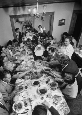 Vintage photo of an Italian family having dinner. This reminds me of my families holiday dinners (minus the nun). #tistheseason to #tuckernuck