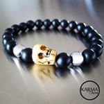 Antique hand carved skull bead from Tibet made of Yak bone. Conquers demons and demonic influences. Symbolizes the impermanence of life. A smile for people who are free of discriminating thoughts. A reminder that all is perishable. With big Onyx and Hematite beads (8mm/0.314') it makes hell of a bracelet!