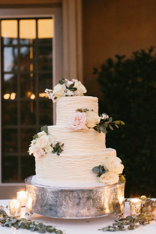 Elegant three tier flower topped textured wedding cake: http://www.stylemepretty.com/california-weddings/agoura-hills/2016/10/01/romantic-dusk-backyard-wedding/ Photography: Meghan Kay Sadler - http://www.mksadler.com/
