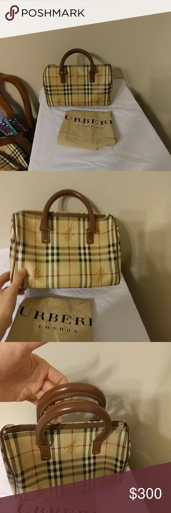 Burberry bag Pre owned. Authentic Burberry bag just have lit bit stain that you can see in photos overall very good condition..please check all photos Burberry Bags Mini Bags