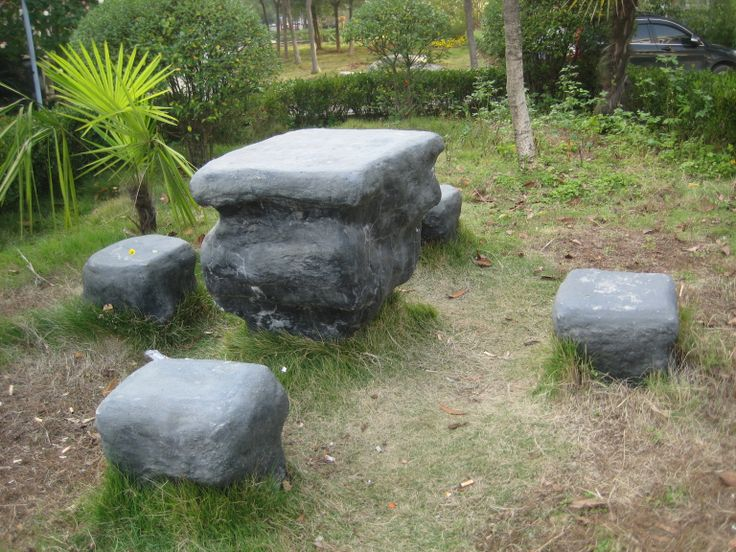 Stone table in Apt complex gardens...