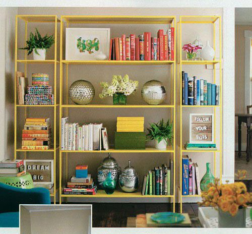 books and objects arranged by color