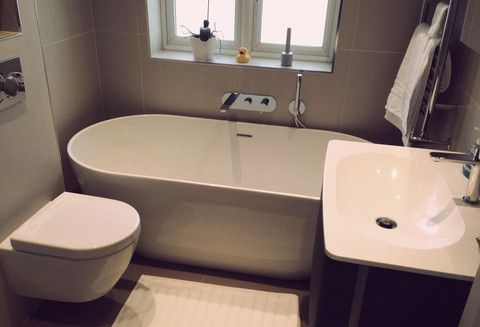 Free standing bath in small space, bit neat but looks okay, like the inset taps. If no room for hidden shelves, could build ledges into tiled plaster board  wall.
