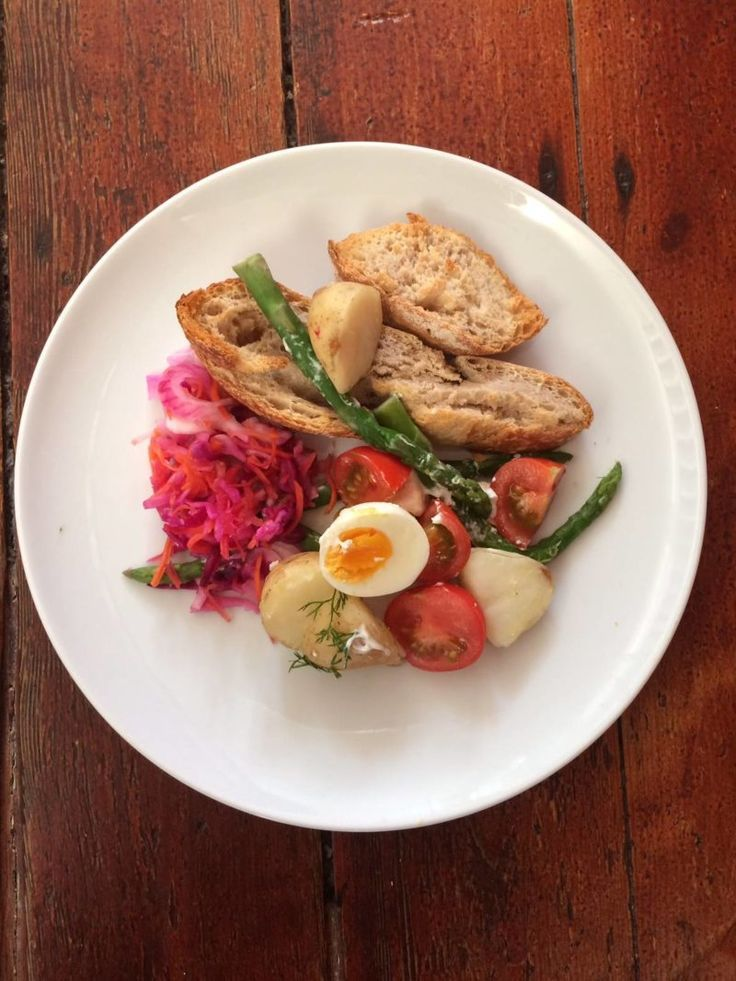 Warm Cypriot Salad with goats ceese, Cypriot new potoes, asparagus, eggs and amber and rosso tomatoes. An easy vegetarian recipe