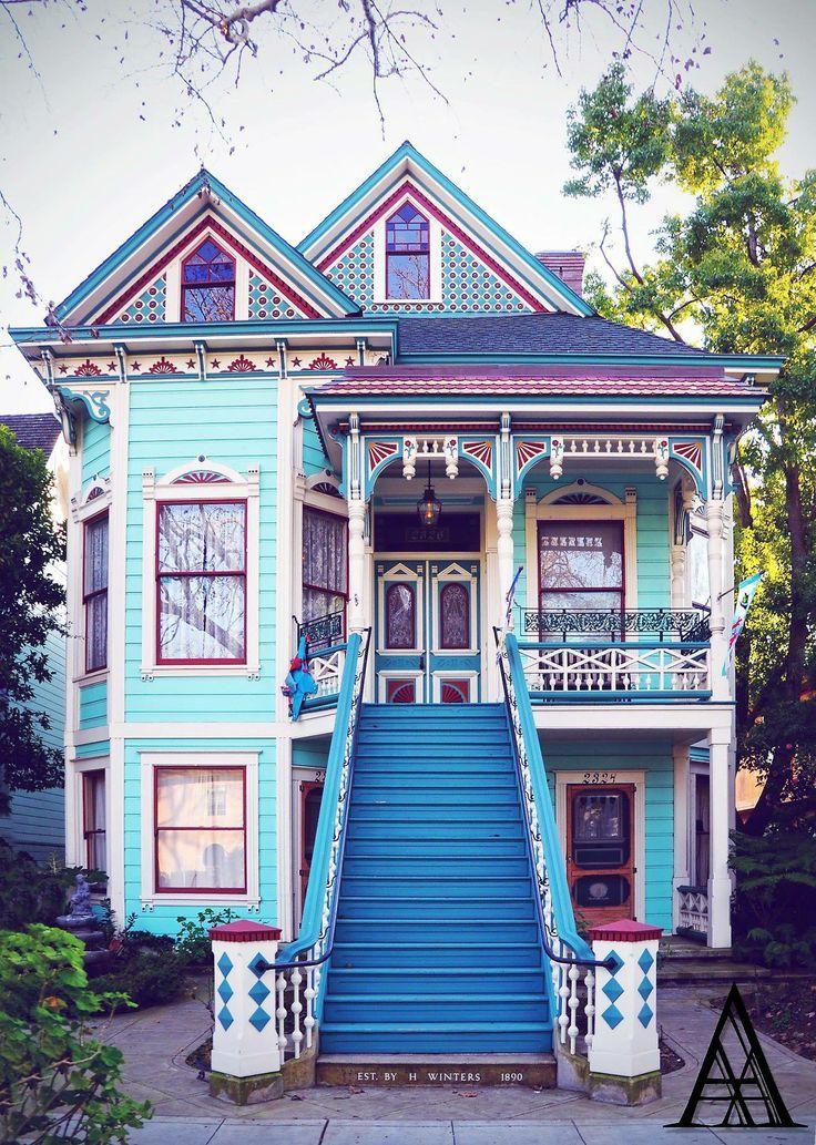 victorian house in blue and pink                                                                                                                                                     More