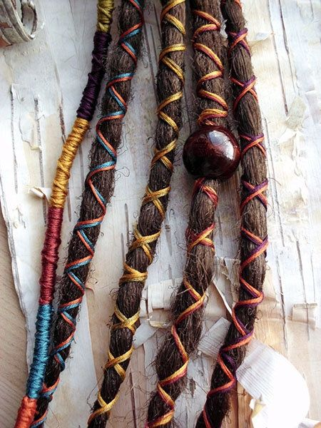 dread wraps and a wooden bead....wouldn't do dreads in a million years!  Yuck!  But would love to do this to some braids here and there in my hair!