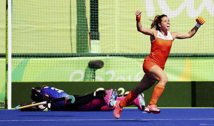 Ellen Hoog of Netherlands (R) celebrates after scoring the winning goal during the penalty shootout against Germany in the women's hockey semifinals at the Olympic Hockey Center on August 17, 2016. (REUTERS/Vasily Fedosenko)