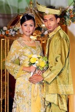 Traditional: Display of Malay wedding costumes.