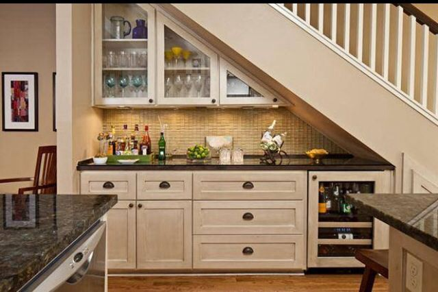I like how the space under the stairs is incorporated into the rest of the kitchen