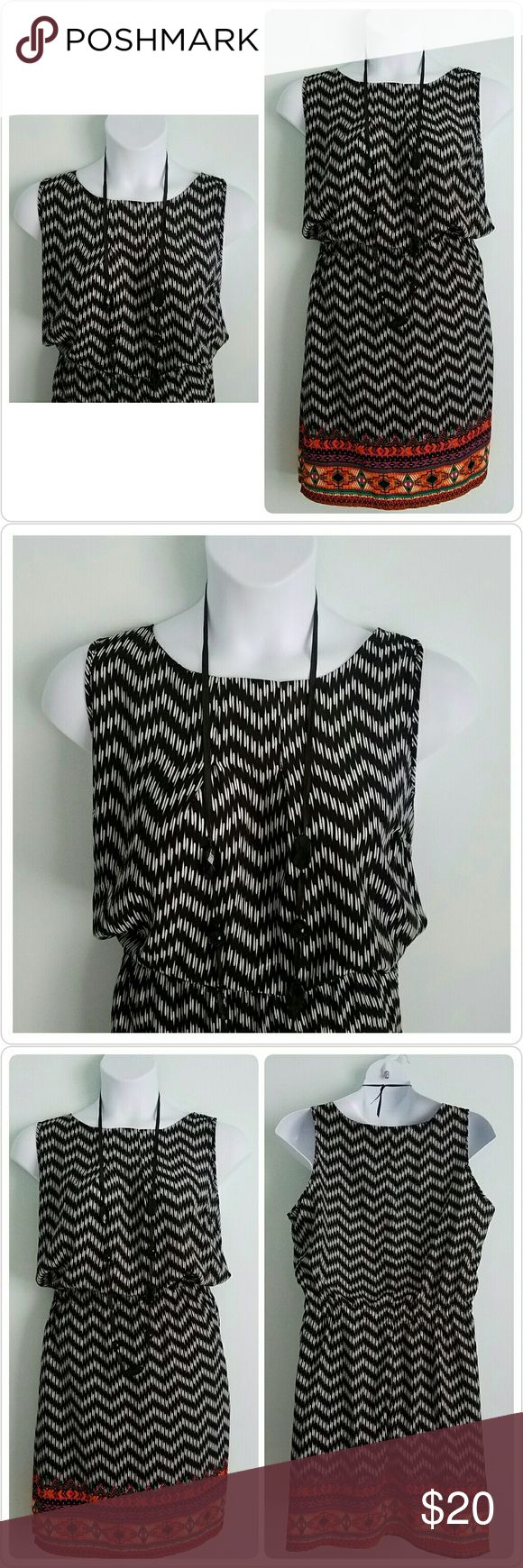 Feathers Plus Black & White Zig Zag Aztec Dress Brand: Feathers  Size: 2x  Condition: Excellent preloved, no issues Color: Black, White, Orange, Purple Lined: No Sleeve Style: Sleeveless  Occasion: Career or Casual Dress Length: Knee  Material: 100% Polyester  Machine Washable: Yes Zipper: No  Bust: 23 Waist: 18 Stretch  Hips: 26 Length: 40 Special features: Pockets with Zippers  Please let me know if you have any questions. Thank you for looking! Xoxoxoxo Feathers Dresses