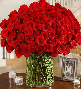 100 Premium Long Stem Red Roses in a Vase. this is one of those flower arrangements that you'd only get once in life, it would be that awesome!