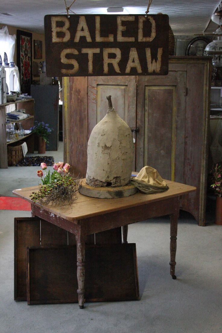 Early Mud And Wattle Bee Skep Paired With A Fantastic Old Metal Baled Straw Sign