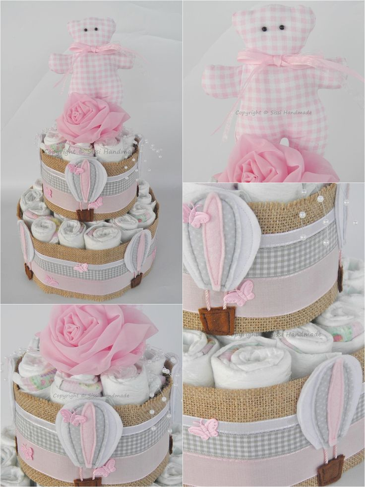 Torta di pannolini con mongolfiere e orsetto rosa