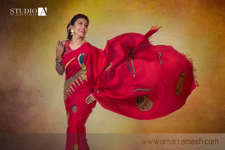 Celebrate Indian crafts with this ravishing bright red kanchipuram silk saree embellished with Indian musical instruments in kalamkari embroidery