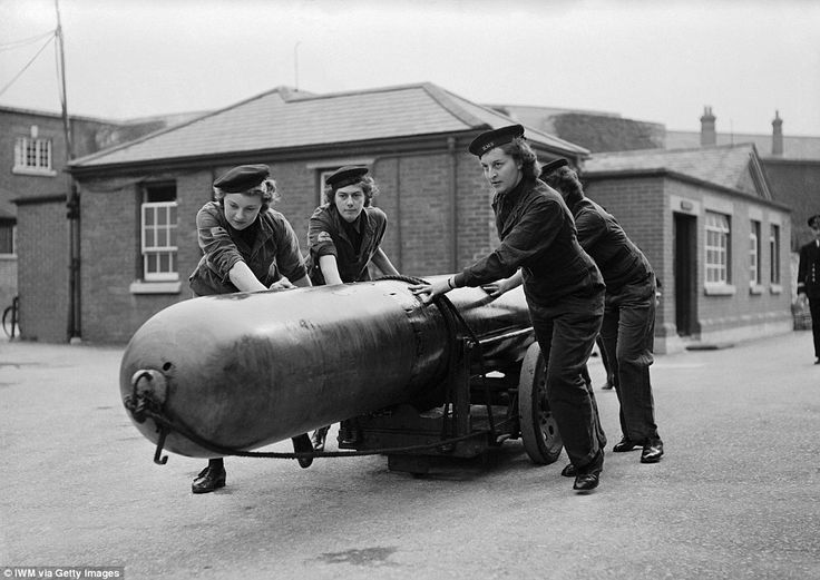 Deadly: WRNS based at the enormous British naval base at Portsmouth move a torpedo towards a loading bay used by one of the Navy's U-class submarines