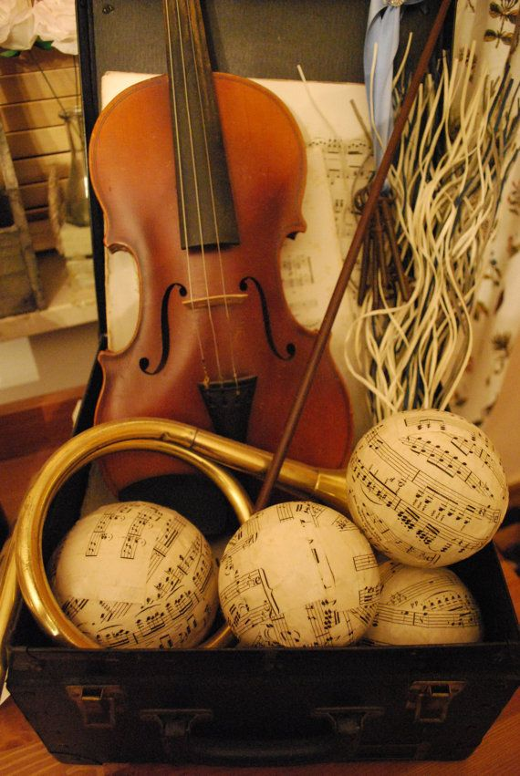 Sheet Music Covered Balls; this would be great for Jaylee music room