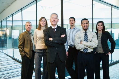 High-Res Stock Photography: Group of business colleagues smiling portrait