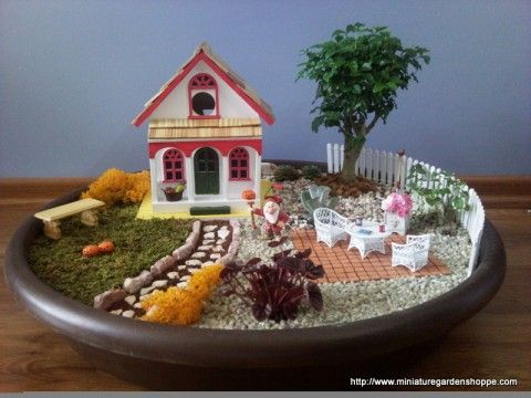 miniature garden ___a birdhouse was painted to look like a miniature fairy house