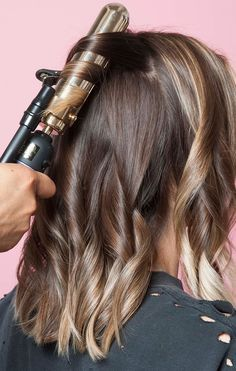 """The 3 hairstyles fashion girls LOVE right now. """"a choppy long bob, slightly shorter in the back, with a soft undercut and lots of shaggy layers"""""""