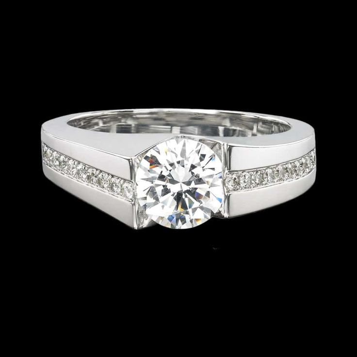 Lumina ring is sleek and refined. This stunning diamond ring features a 1.00 carat diamond set in white gold with .23 cttw diamond accents. Looking for the perfect center stone? We offer GIA expertise and competitive pricing for diamonds and colored gemstones. If you already have a center stone we can set it for you.