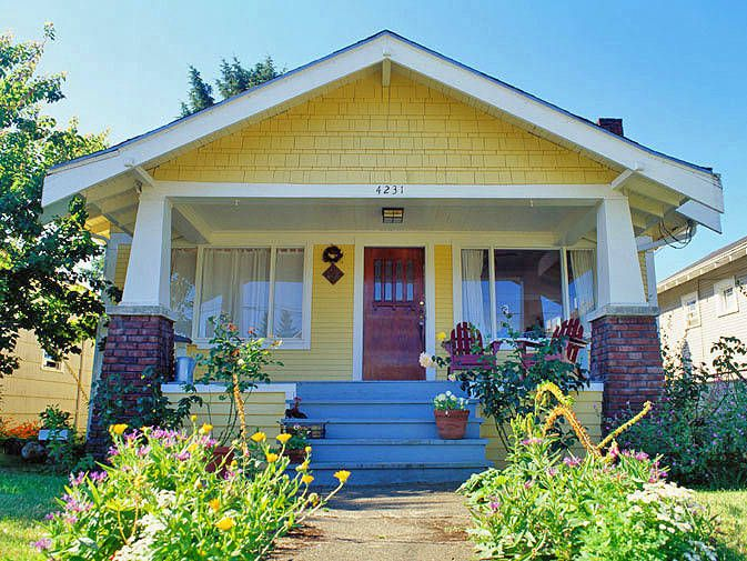 Luxury 12 Tips to Pick the Perfect House Colors A colorful garden inspired the paint color for this cheerful yellow bungalow - Cool front door colors for yellow house Modern