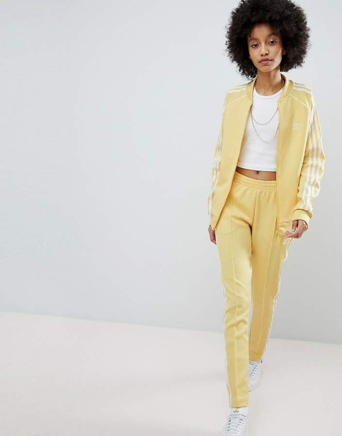 7f1fa52652ff ASOS - adidas Originals adicolor Three Stripe Track Pants In Yellow --   Check it out now  adidas  adidasoriginals  asos  pants  womens  fashion    ...