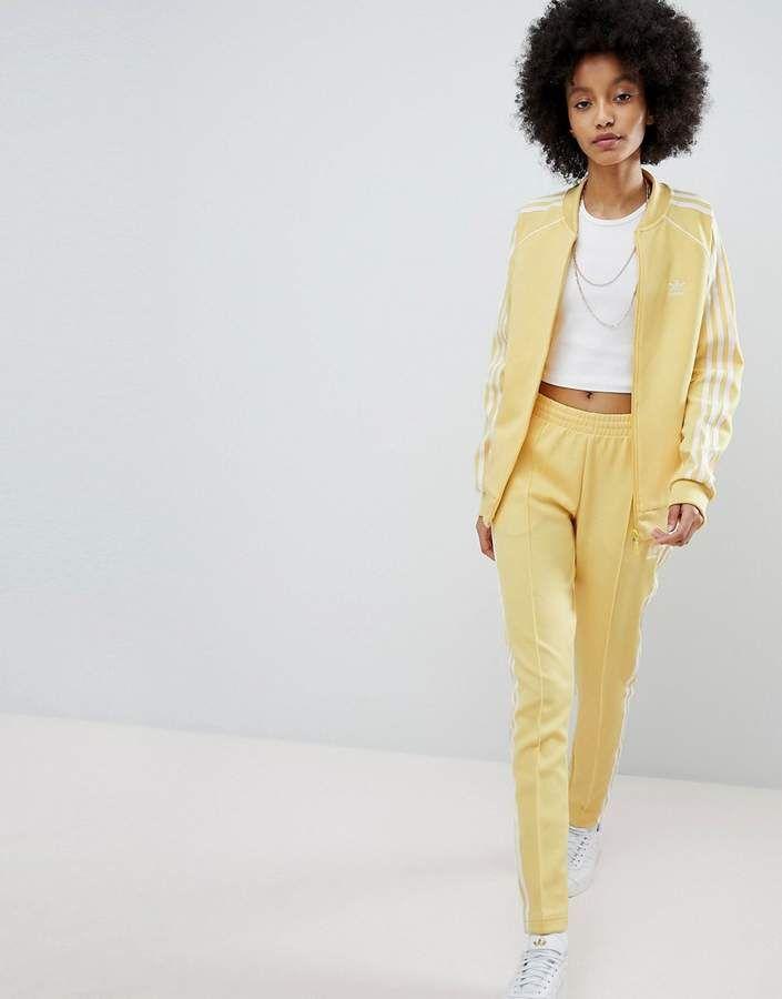 51e502f3c03e adidas Originals adicolor Three Stripe Track Pants In Yellow ...