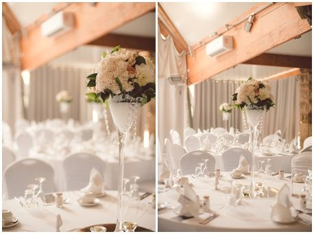 Floral martinis centerpieces with hanging jewels without the LED lights, which were placed before the reception