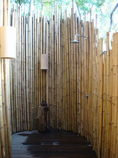 Outdoor shower. Bamboo is more resilient than wood, but still not perfect for th