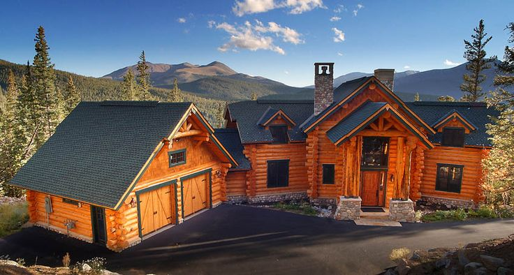 This beautiful full stacked custom handcrafted log house is situated in the mountains of Breckenridge, Colorado. The back of this log house features a large sun deck with handcrafted log railing. The log garage is joined to the log house by a breezeway. Unique tall character logs are used as support posts for the dramatic entryway.