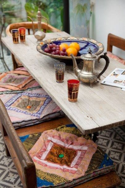 I love these Moroccan inspired tea nooks. All it takes is a few pillows and a coffee table... And maybe a really awesome tea set.