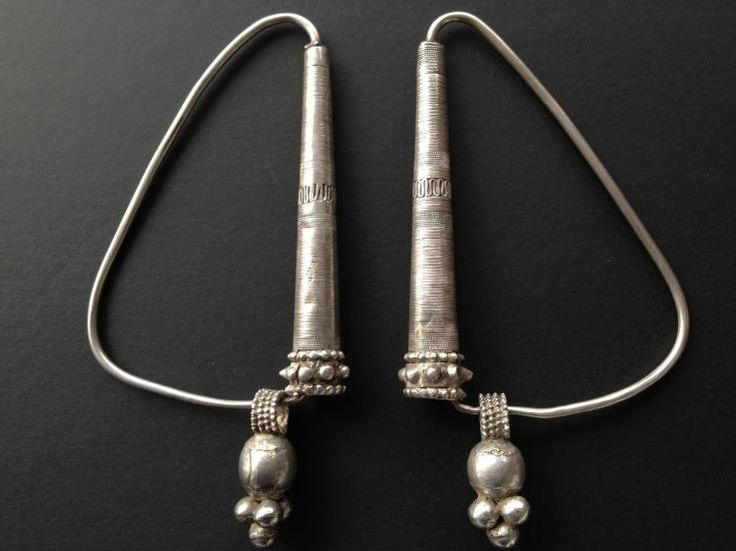 """Omani silver earrings or stunning form, used as part of a headdress. Posted by Jose M. Pery on """"ethnic jewels""""."""