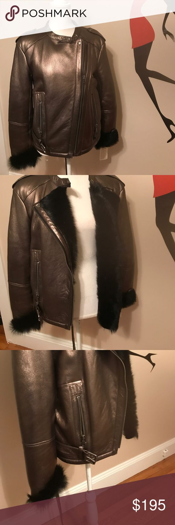 Gorgeous NWT Gerard Darel leather bomber Gorgeous NWT Gerard Darel leather bomber jacket, fur lined. I'm not sure what the fur is.  This jacket retails for $2260, as shown on the tag. There is a small defect around the collar, as depicted in photo four.  It is a small tear. Therefore, I am offering this jacket at a very very affordable price. It is 24 inches long. Sleeve length is 24.armpit to armpit is 21 inches. Gerard Darel Jackets & Coats Utility Jackets