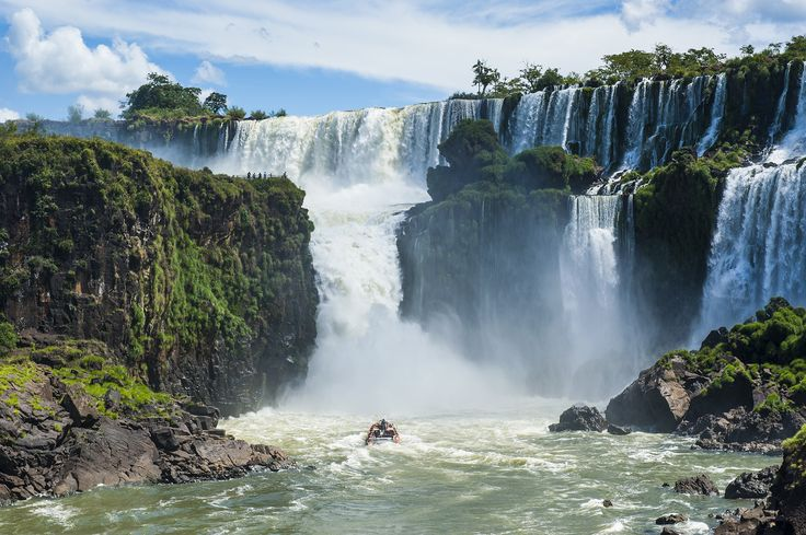 """IGUAZÚ NATIONAL PARK, ARGENTINA Iguazú National Park is surrounded by the subtropical forest and is centered around the mighty Iguazú Falls, whose name is derived from the local language meaning """"big water."""" The falls are composed of 275 individual drops, running nearly two miles along the border of Brazil and Argentina. The park was declared a World Heritage Site in 1984."""