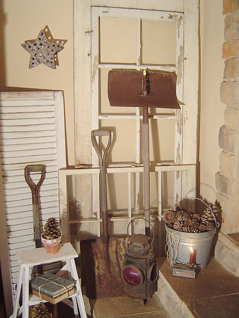 rusty shovels and old window frames - maybe an idea in here - step stool table