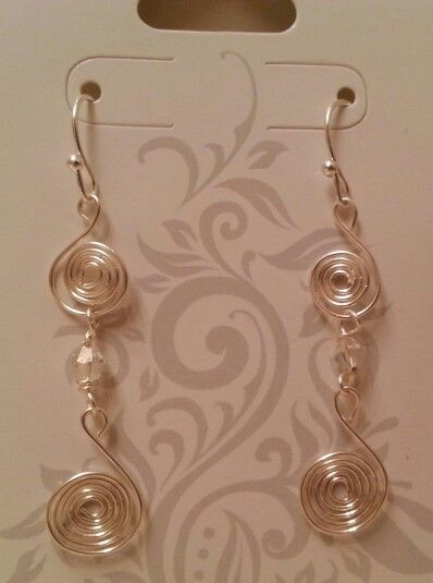 Silver swirls w/clear bead