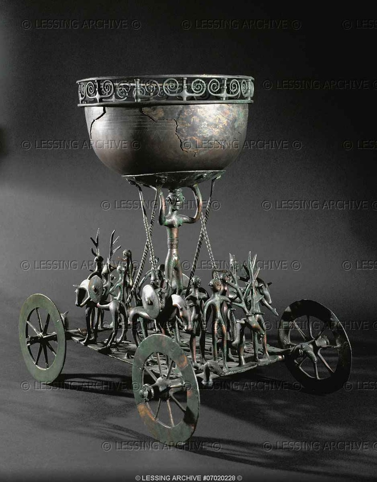 Hallstatt culture votive gift, 1oth-6th century BCE. Cult-chariot of Strettweg (7th BCE). A funerary gift for a prince whose ashes were buried in a hill tumulus. The chariot shows a sacrificial procession, with the stag as victim, sacrificed to the tall female goddess by the naked man with the axe. Bronze, height 33 cm