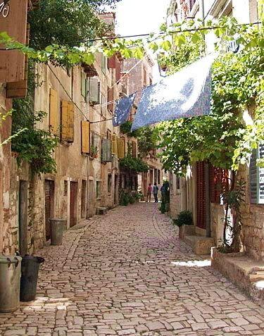 Romantic street in Rovinj (Croatia)  Imagine just walking along.. not even talking...Oh my....