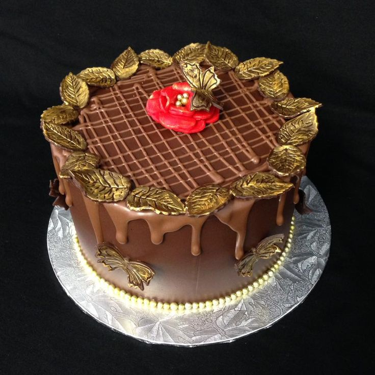 Chocolate Fondant Covered Cake with Modelling Chocolate (Choccit) gold leaves. Decorated by Coast Cakes Ltd