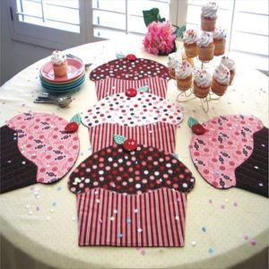 Cupcake Party...could DIY giant fabric cup cakes for a table runner?