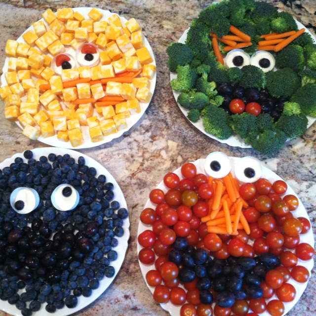 Sesame Street fruit & veggie trays! Made for My daughter's 2nd bday party:) Big bird- cheese cubes, carrots  Oscar- broccoli, carrots, black grapes, tomato  Cookie Monster- blueberries, black grapes Elmo- tomato, carrot, black grapes So fun to make and kids & adults loved :)