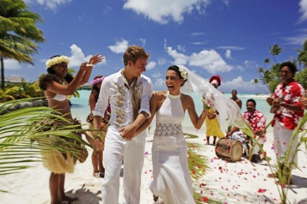 Tahiti wedding right before the family leaves, then stay for honeymoon.  K's family comes over too.