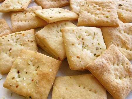 Gourmet soda cracker recipe from King Arthur Flour - this would be a good basis for creating a gluten-free version. Millet, sorghum, brown rice, teff, sweet rice, tapioca?