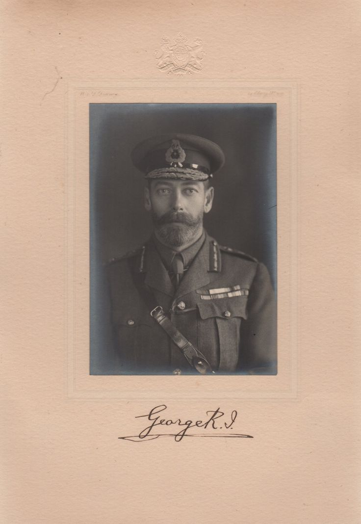 GEORGE V: (1865-1936) King of the United Kingdom 1910-36. A very fine vintage signed 7.5 x 10.5 photograph, the image depicting the King in a formal half length pose wearing his military uniform and cap. Photograph by W & D Downey of London and bearing a blind embossed Royal Coat of Arms to the upper photographer's mount. Signed ('George R. I.') by the King in bold, dark fountain pen ink with his name alone to the lower photographer's mount.