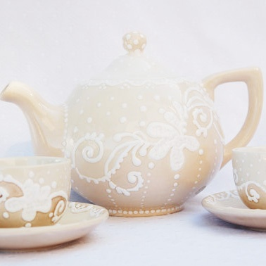 Love this handpainted tea set in ivory...from clayful impressions.