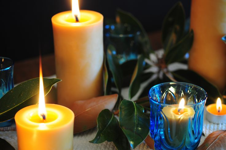 Lay branches of magnolia down the center of your table, carefully turning some leaves over to show off their gorgeous velvet.  Use vintage glasses for beeswax votives and tea lights, and ground the scene with large basic beeswax pillar.