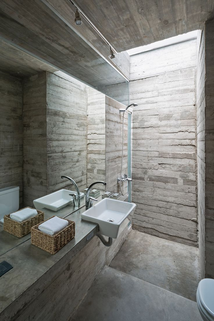 Board-formed concrete also features in the bathroom of L4 House by Luciano Kruk Arquitectos in Costa Esmeralda, Argentina