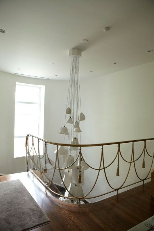 Love the railing, and that light fixture!  Original Art Deco staircase -- so lovely! From Creative Spaces: One of Canada's Most Notable Art Deco Homes