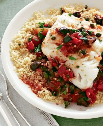 Recipe for hake Livornese with couscous - a must-try! The Tuscan seaport town of Livorno is famous for this simple preparation of white fish.
